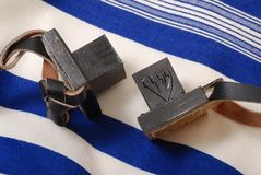 Tefillin. (phylacteries) worn by Jewish men for morning prayers.  On blue Tallit (prayer shawl Stock Photo