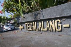 Tegalalang inskrift med piltecknet royaltyfria bilder
