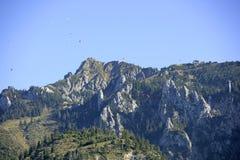 Tegelberg Mountain near Schwangau, Bavaria. Paraglider in the sky at Tegelberg Mountain, Schwangau, Ostallgaeu district, Allgaeu, Bavaria, Germany, Europe Stock Images