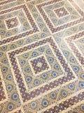 Tegelplattatappning på golv Arkivfoto