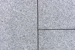 Tegelplattor eller tjock skiva för grå och kornig granit- eller marmortextur royaltyfri fotografi