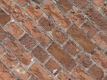 tegelplattor för bakgrund för vägg för röd tegelsten diagonala arkivbild