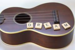 Tegelplattor för bokstav för ukuleledrömfyrkant på vit Royaltyfria Bilder