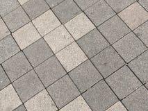 Tegelplattor i grå färger arkivfoto