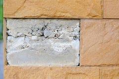 Tegelplattor ut ur väggen Fotografering för Bildbyråer