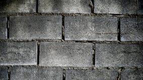 Tegelsten blockerar bakgrund som vägg för bakgrundscementbruk Arkivbild