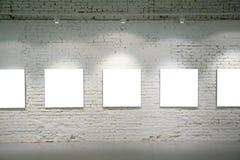 tegelsten inramniner väggen Arkivbild