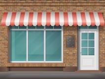 Tegelsten shoppar fasadmarkisen Arkivbild