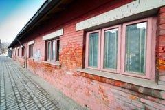 tegelsten som bygger den röda väggen arkivfoto