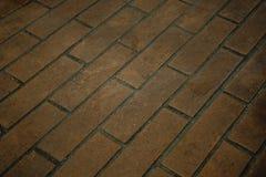 Tegelsten stenlagt golv royaltyfri bild