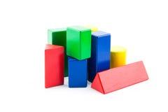 tegelstenar för konstruktion för byggnad för leksakträsnitt flerfärgade Arkivfoto