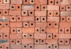 Tegelstenar för röd lera för konstruktion Royaltyfri Fotografi