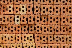 Tegelstenar som används för byggnadskonstruktion Arkivbild