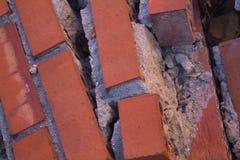 Tegelstenar som demoleras från arbete av reform royaltyfri foto