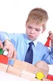 tegelstenar som leker schoolboyen Arkivfoton