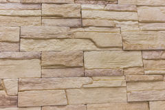 Tegelstenbakgrundsabstrakt begrepp textureweathered textur av nedfläckat gammalt ljus - brun stuckatur och målad röd gul vägg in Arkivfoto
