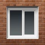 tegelstenbyggnad dekorerar utanför till det använda väggfönstret Arkivbild