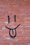 tegelstengrafitti ler väggen Fotografering för Bildbyråer