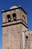 TegelstenKlocka torn Cusco Peru South America Blue Sky fotografering för bildbyråer