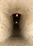 Tegelstenkorridor och trappa Royaltyfri Foto