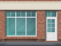 Tegelstenlagerframdel med det stora genomskinliga fönstret Arkivfoton
