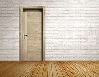 Tegelstenrum med den moderna dörren royaltyfri bild