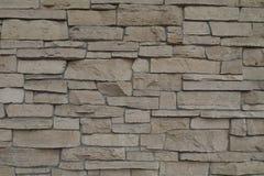 Tegelstenvägg av den ojämna stenen av olika format för textur och bakgrund Royaltyfria Bilder