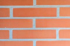 Tegelstenvägg, gammal textur av den röda stenkvartercloseupen arkivbilder