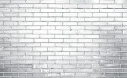 Tegelstenvägg, grå backgraund royaltyfria bilder