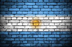 Tegelstenvägg med den målade flaggan av Argentina royaltyfri illustrationer