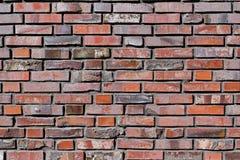 Tegelstenvägg med gråa och röda tegelstenar Royaltyfri Foto