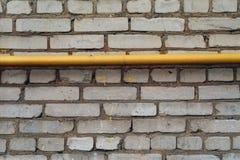 Tegelstenvägg med röret Fotografering för Bildbyråer