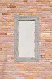 Tegelstenvägg med ramen Royaltyfri Fotografi