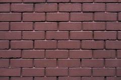 Tegelstenvägg som göras av röd stenbakgrund Den bortskämda tegelstenen är tappning arkivbilder