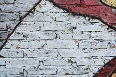 Tegelstenvägg som målas i olika färger Royaltyfri Fotografi