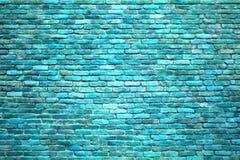 Tegelstenväggen av blått färgar, texturen av stenyttersidan arkivfoto