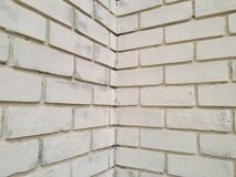 Tegelstenvägg med av vit färg Fotografering för Bildbyråer