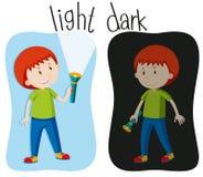 Tegenovergestelde bijvoeglijke naamwoorden met licht en dark Stock Fotografie