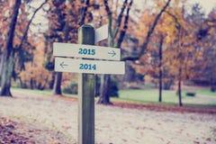 Tegenovergestelde richtingen naar jaar 2014 en 2015 Royalty-vrije Stock Foto's