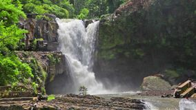 Tegenungan Waterfall. Located in plateau area and it is one of places of interest of Bali stock video