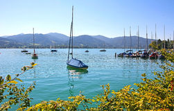 Tegernsee lake shore with moored sailing boats Stock Photography