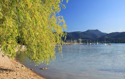 Tegernsee lake shore with view to mountains and boats Stock Images