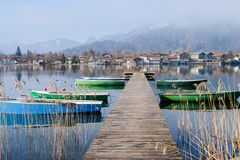 Tegernsee lake view panorama from a wooden Pier. Bayern, Germany. Tegernsee lake view panorama wooden pier german bayern germany boats fog village reflection royalty free stock photo