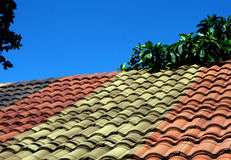 Tegula Roofing. Tegula bricks roofing in mixed colors suitable for backgrounds Stock Photos