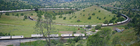 The Tehachapi Train Loop near Tehachapi California is the historic location of the Southern Pacific Railroad where freight trains  Stock Photos
