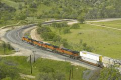 The Tehachapi Train Loop near Tehachapi California is the historic location of the Southern Pacific Railroad where freight trains. Gain 77 feet in elevation and royalty free stock photos