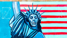 TEHERAN, IRAN - NOVEMBER 05, 2016: Iranian propaganda mural at the wall of former US embassy in Teheran. Royalty Free Stock Images