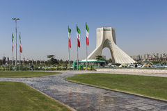 TEHERAN, IRAN - OCTOBER 03, 2016: Azadi Tower with flasgs of Ira. N, Tehran, Iran stock image