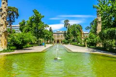 Tehran Golestan Palace 31. Tehran Golestan Palace Talar-e Salam Reception Hall Frontal View Point with Garden Pond and Fountain royalty free stock photos