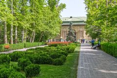 Tehran Green Palace Museum in the park. TEHRAN, IRAN - MAY 1, 2015: Walkers walking from the park to the Green Palace Museum Sabz in a beautiful sunny day stock image